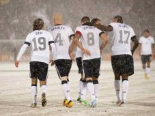 The boys celebrate in the snow after Dempsey's goal.